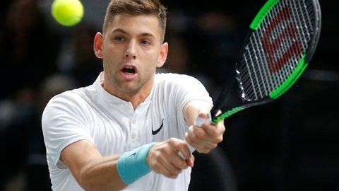 Filip Krajinovic of Serbia returns the ball to John Isner of the United States during their semifinal match of the Paris Masters tennis tournament at the Bercy Arena in Paris, France, Saturday, Nov. 4, 2017. (AP Photo/Michel Euler)