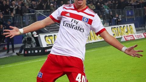 Hamburg's Jann-Fiete Arp celebrates his goal during the German Bundesliga soccer match between Hamburger SV and VfB Stuttgart in the Volksparkstadion in Hamburg, Germany, Saturday, Nov. 4, 2017.  (Christian Charisius/dpa via AP)