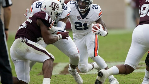 Auburn running back Kerryon Johnson (21) cuts to a hole against Texas A&M during the first half of an NCAA college football game on Saturday, Nov. 4, 2017, in College Station, Texas. (AP Photo/Sam Craft)