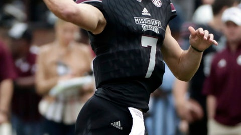 Mississippi State quarterback Nick Fitzgerald (7) readies to pass against Massachusetts during the first half of an NCAA college football game in Starkville, Miss., Saturday, Nov. 4, 2017. (AP Photo/Rogelio V. Solis)