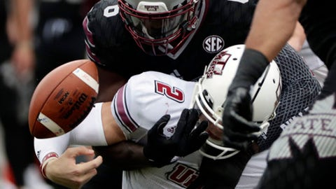 Mississippi State linebacker Willie Gay Jr. (6) forces Massachusetts quarterback Ross Comis (2) to fumble during the first half of an NCAA college football game in Starkville, Miss., Saturday, Nov. 4, 2017. (AP Photo/Rogelio V. Solis)