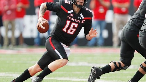 Texas Tech quarterback Nic Shimonek scrambles for a first down against Kansas State during the first half of an NCAA college football game Saturday, Nov. 4, 2017, in Lubbock, Texas. (Mark Rogers/Lubbock Avalanche-Journal via AP)