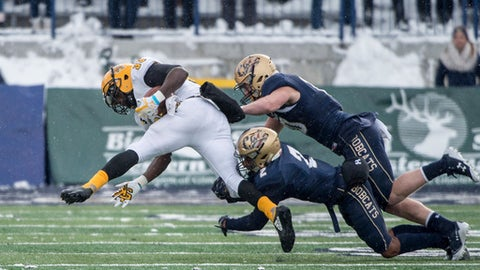 Montana State cornerback Tyrel Thomas (2) and defensive back Bryson McCabe (10) tackle Kennesaw State running back Darnell Holland (33) during the first half an NCAA college football game in Bozeman, Mont. Saturday, Nov. 4, 2017. (Colter Peterson/Montana State University via AP)