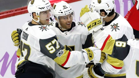 Vegas Golden Knights center Jonathan Marchessault (81) celebrates his goal with left wing David Perron (57) and left wing James Neal (obscured) during the second period of an NHL hockey game against the Ottawa Senators, Saturday, Nov. 4, 2017 in Ottawa, Ontario. (Fred Chartrand /The Canadian Press via AP)