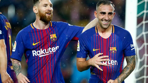 FC Barcelona's Paco Alcacer, right, celebrates after scoring with his teammate Lionel Messi during the Spanish La Liga soccer match between FC Barcelona and Sevilla at the Camp Nou stadium in Barcelona, Spain, Saturday, Nov. 4, 2017. (AP Photo/Manu Fernandez)