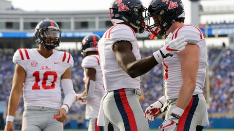 Mississippi wide receiver A.J. Brown celebrates with tight end Dawson Knox, right, after Brown scored a touchdown during the first half of an NCAA college football game against Kentucky, Saturday, Nov. 4, 2017, in Lexington, Ky. (AP Photo/David Stephenson)