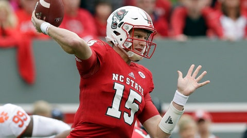 North Carolina State quarterback Ryan Finley (15) passes during the first half of an NCAA college football game against Clemson in Raleigh, N.C., Saturday, Nov. 4, 2017. (AP Photo/Gerry Broome)