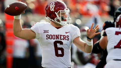 Oklahoma quarterback Baker Mayfield (6) throws in the first half of an NCAA college football game against Oklahoma State in Stillwater, Okla., Saturday, Nov. 4, 2017. (AP Photo/Sue Ogrocki)
