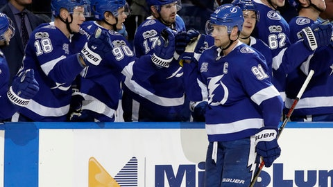 Tampa Bay Lightning center Steven Stamkos (91) celebrates with the bench after scoring against the Columbus Blue Jackets in a shootout of an NHL hockey game Saturday, Nov. 4, 2017, in Tampa, Fla. The Lightning won the game 5-4. (AP Photo/Chris O'Meara)