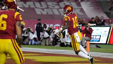 Southern California wide receiver Jalen Greene, right, celebrate his touchdown after picking up a blocked punt during the first half of an NCAA college football game against Arizona, Saturday, Nov. 4, 2017, in Los Angeles. (AP Photo/Mark J. Terrill)