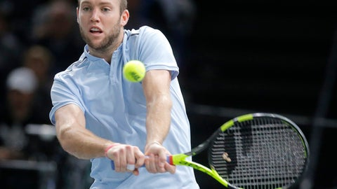 Jack Sock of the United States returns the ball to Filip Krajinovic of Serbia during their final match of the Paris Masters tennis tournament at the Bercy Arena in Paris, France, Sunday, Nov. 5, 2017. (AP Photo/Michel Euler)