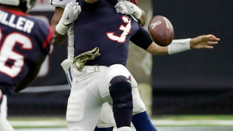 Houston Texans quarterback Tom Savage (3) is hit by Indianapolis Colts inside linebacker Jon Bostic (57) as he tries to throw during the first half of an NFL football game Sunday, Nov. 5, 2017, in Houston. (AP Photo/David J. Phillip)