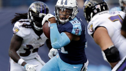 Tennessee Titans free safety Kevin Byard (31) runs back a pass interception against the Baltimore Ravens in the first half of an NFL football game Sunday, Nov. 5, 2017, in Nashville, Tenn. (AP Photo/Wade Payne)