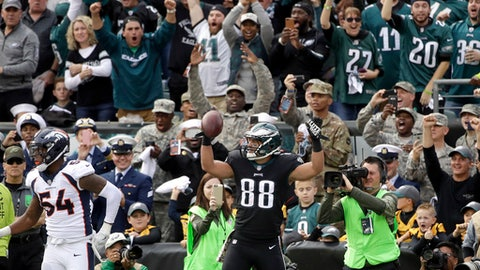 Philadelphia Eagles' Trey Burton (88) celebrates after scoring a touchdown past Denver Broncos' Brandon Marshall (54) during the first half of an NFL football game Sunday, Nov. 5, 2017, in Philadelphia. (AP Photo/Matt Rourke)