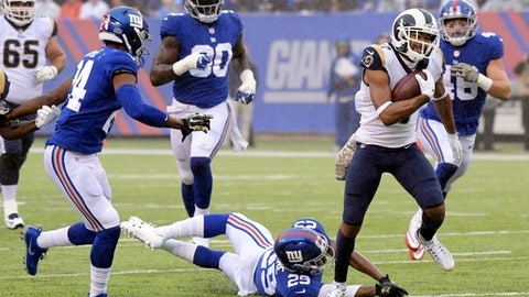 Los Angeles Rams' Robert Woods (17) breaks a tackle by New York Giants' Nat Berhe (29) to run for a touchdown during the first half of an NFL football game, Sunday, Nov. 5, 2017, in East Rutherford, N.J. (AP Photo/Bill Kostroun)