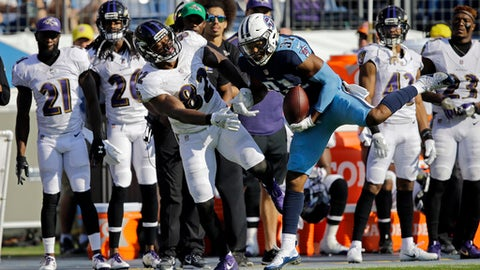 Tennessee Titans free safety Kevin Byard (31) intercepts a pass intended for Baltimore Ravens tight end Benjamin Watson (82) in the second half of an NFL football game Sunday, Nov. 5, 2017, in Nashville, Tenn. It is the second interception of the game for Byard. (AP Photo/James Kenney)