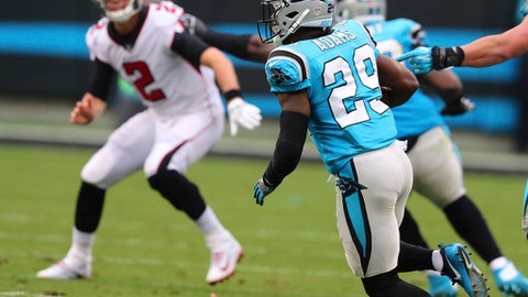 Atlanta Falcons quarterback Matt Ryan is intercepted by Carolina Panthers safety Mike Adams during the second quarter of an NFL football game on Sunday, Nov. 5, 2017, in Charlotte, N.C. (Curtis Compton/Atlanta Journal-Constitution via AP)