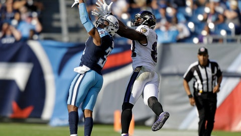 CORRECTS TO REMOVE SCORE - Tennessee Titans free safety Kevin Byard (31) intercepts a pass intended for Baltimore Ravens tight end Benjamin Watson (82) in the second half of an NFL football game Sunday, Nov. 5, 2017, in Nashville, Tenn. (AP Photo/Wade Payne)
