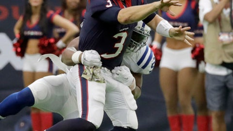 Houston Texans quarterback Tom Savage (3) tosses the ball as he is hit by Indianapolis Colts inside linebacker Jon Bostic (57) during the second half of an NFL football game Sunday, Nov. 5, 2017, in Houston. (AP Photo/David J. Phillip)