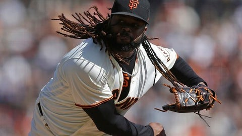 San Francisco Giants pitcher Johnny Cueto works against the San Diego Padres in the second inning of a baseball game Sunday, Oct. 1, 2017, in San Francisco. (AP Photo/Ben Margot)