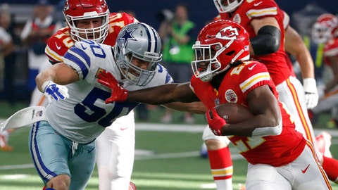 Dallas Cowboys linebacker Sean Lee (50) attempts to stop Kansas City Chiefs running back Kareem Hunt (27) in the first half of an NFL football game, Sunday, Nov. 5, 2017, in Arlington, Texas. (AP Photo/Michael Ainsworth)