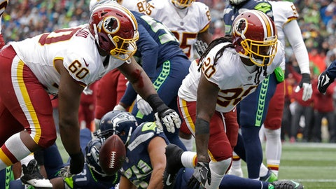 Washington Redskins running back Rob Kelley (20) gets up after he scored a 1-yard rushing touchdown against the Seattle Seahawks in the first half of an NFL football game, Sunday, Nov. 5, 2017, in Seattle. (AP Photo/Elaine Thompson)