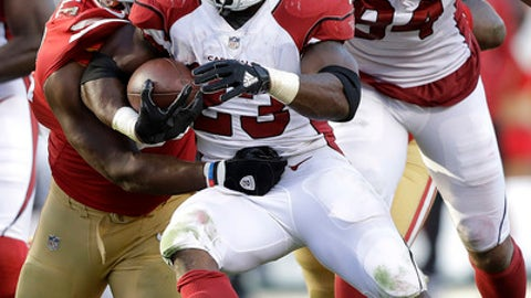 Arizona Cardinals running back Adrian Peterson (23) runs against San Francisco 49ers defensive end Leger Douzable during the second half of an NFL football game in Santa Clara, Calif., Sunday, Nov. 5, 2017. (AP Photo/Marcio Jose Sanchez)
