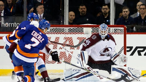New York Islanders center Jordan Eberle (7) takes a shot against Colorado Avalanche goalie Jonathan Bernier (45) for the Islanders' second goal during the first period of an NHL hockey game in New York, Sunday, Nov. 5, 2017. (AP Photo/Kathy Willens)