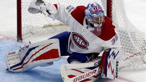 Montreal Canadiens goalie Charlie Lindgren blocks a shot against the Chicago Blackhawks during the second period of an NHL hockey game, Sunday, Nov. 5, 2017, in Chicago. (AP Photo/Nam Y. Huh)