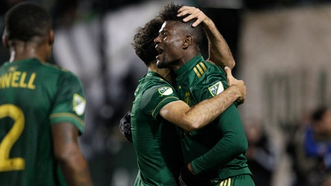Houston Dynamo's Dairon Asprilla celebrates a goal with teammates during the second leg of their 2017 MLS Cup soccer playoffs matchup of the Western Conference Semifinals against the Portland Timbers in Portland, Ore. on Sunday, Nov. 5, 2017. (Sean Meagher/The Oregonian via AP)