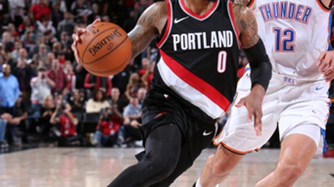 PORTLAND, OR - NOVEMBER 5:  Damian Lillard #0 of the Portland Trail Blazers handles the ball against the Oklahoma City Thunder on November 5, 2017 at the Moda Center in Portland, Oregon. NOTE TO USER: User expressly acknowledges and agrees that, by downloading and or using this photograph, user is consenting to the terms and conditions of the Getty Images License Agreement. Mandatory Copyright Notice: Copyright 2017 NBAE (Photo by Sam Forencich/NBAE via Getty Images)