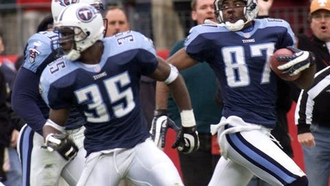 FILE - In this Jan. 8, 2000, file photo, Tennessee Titans wide receiver Kevin Dyson (87) looks back as he returns a kickoff with seconds remaining in the fourth quarter to defeat the Buffalo Bills in their AFC wild card football game in Nashville, Tenn. The ball was lateraled twice on the return and Dyson took it to the end zone. Blocking for Dyson are Perry Phenix (35) and Greg Favors (51). For every unplanned play that earns a name like the Immaculate Reception or the Musoc City Miracle, there's a gimmick cooked up by coaches to catch a defense by surprise. (AP Photo/Wade Payne, File)