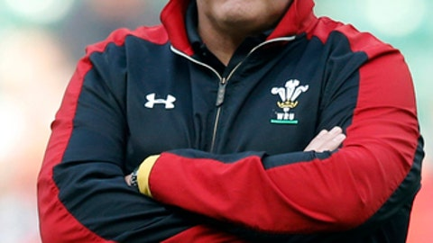 FILE - This is a Saturday, March,12, 2016 file photo of Wales' Head Coach Warren Gatland  as he watches the warmup before the Six Nations international rugby match between England and Wales at Twickenham stadium in London. One of rugby's fiercest rivalries was briefly set aside when England and Wales joined for a training session on Monday Nov. 6, 2017, to hone their set-pieces ahead of the autumn international series. England forwards coach Steve Borthwick brokered an unprecedented arrangement between the two nations for a 40-minute practice session in Bristol, a city located approximately halfway between the rivals' training bases.   (AP Photo/Alastair Grant/File)