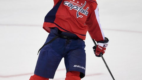 Washington Capitals defenseman John Carlson (74) celebrates his game-winning goal during overtime of an NHL hockey game against the Arizona Coyotes, Monday, Nov. 6, 2017, in Washington. The Capitals won 3-2 in overtime. (AP Photo/Nick Wass)