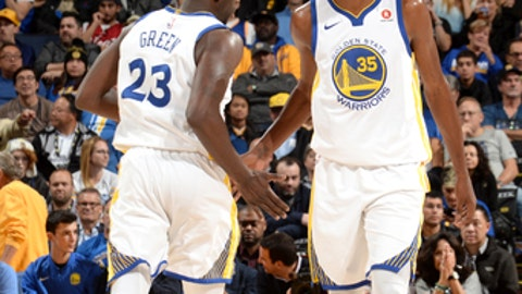 OAKLAND, CA - NOVEMBER 6:  Kevin Durant #35 and Draymond Green #23 of the Golden State Warriors high five during the game against the Miami Heat on November 6, 2017 at ORACLE Arena in Oakland, California. NOTE TO USER: User expressly acknowledges and agrees that, by downloading and or using this photograph, user is consenting to the terms and conditions of Getty Images License Agreement. Mandatory Copyright Notice: Copyright 2017 NBAE (Photo by Noah Graham/NBAE via Getty Images)