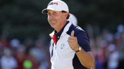 FILE - In this Oct. 2, 2016, file photo, United States' Phil Mickelson gives a thumbs up after winning the 15th hole during a singles match at the Ryder Cup golf tournament, at Hazeltine National Golf Club in Chaska, Minn. Mickelson is willing to add tournaments in his bid to make a 12th consecutive Ryder Cup team next year. (AP Photo/David J. Phillip, File)