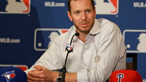 FILE - In this Dec. 9, 2013, file photo, two-time Cy Young Award winner Roy Halladay answers questions after announcing his retirement after 16 seasons in the major leagues with Toronto and Philadelphia at the MLB winter meetings in Lake Buena Vista, Fla. Authorities have confirmed that former Major League Baseball pitcher Roy Halladay died in a small plane crash in the Gulf of Mexico off the coast of Florida, Tuesday, Nov. 7, 2017. (AP Photo/John Raoux, File)