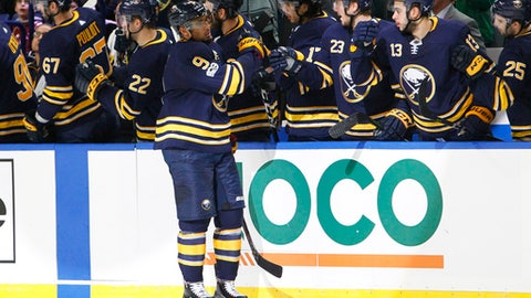 Buffalo Sabres forward Evander Kane (9) celebrates his goal during the second period of an NHL hockey game against the Washington Capitals, Tuesday Nov. 7, 2017, in Buffalo, N.Y. (AP Photo/Jeffrey T. Barnes)