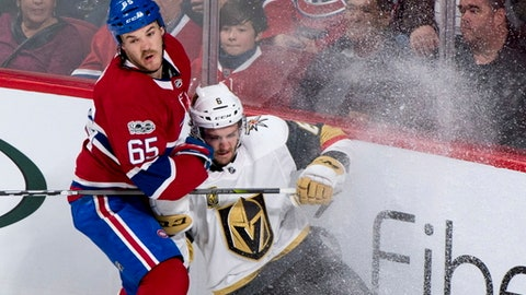 Vegas Golden Knights' Colin Miller is checked by Montreal Canadiens' Andrew Shaw during the second period of an NHL hockey game, Tuesday, Nov. 7, 2017, in Montreal. (Paul Chiasson/The Canadian Press via AP)