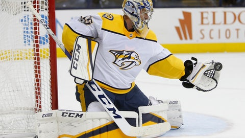 Nashville Predators' Pekka Rinne, of Finland, makes a save against the Columbus Blue Jackets during the second period of an NHL hockey game Tuesday, Nov. 7, 2017, in Columbus, Ohio. The Predators won 3-1. (AP Photo/Jay LaPrete)