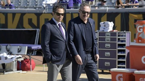 FILE - In this Dec. 11, 2016, file photo, Minnesota Vikings owners Mark Wilf, left, and Zygi Wilf watch warmups on the sideline before an NFL football game between the Vikings and Jacksonville Jaguars in Jacksonville, Fla. The majority owners of the Vikings are joining a group trying to bring a Major League Soccer expansion franchise to Nashville. Mark, Zygi and Leonard Wilf are minority owners in the Nashville project, according to Nashville Soccer Holdings CEO John R. Ingram. Terms of the Wilfs' investment haven't been disclosed. (AP Photo/Phelan M. Ebenhack, File)