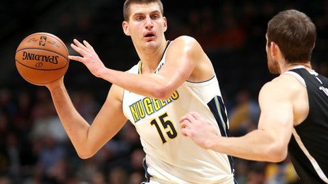 DENVER, CO - NOVEMBER 07: Nikola Jokic #15 looks for an outlet pass while being guarded by Tyler Zeller #44  of the Denver Nuggets puts up a shot over Joe Harris #12 of the Brooklyn Nets at the Pepsi Center on November 7, 2017 in Denver, Colorado. NOTE TO USER: User expressly acknowledges and agrees that, by downloading and or using this photograph, User is consenting to the terms and conditions of the Getty Images License Agreement.  (Photo by Matthew Stockman/Getty Images)
