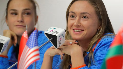 Belarus' Fed Cup team member Aliaksandra Sasnovich, right, speaks, as Aryna Sabalenka looks on during a press conference prior to the Fed Cup by BNP Paribas Final matches between Belarus and USA, in Minsk, Wednesday, Nov. 8, 2017. The matches will take place Nov. 11 - 12, 2017. (AP Photo/Sergei Grits)