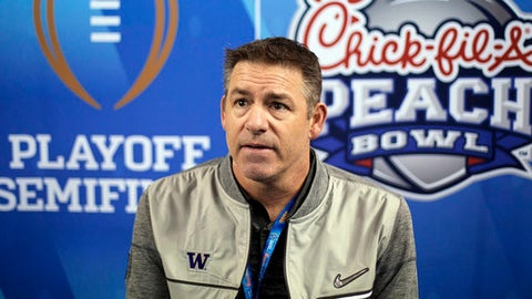 Washington defensive coordinator Pete Kwiatkowski answers a question during media day for the Peach Bowl NCAA college football game against Alabama in Atlanta. Kwiatkowski is the defensive coordinator for No. 9 Wa
