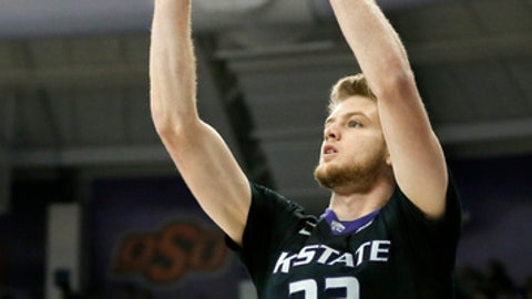 FILE - In this March 1, 2017, file photo, Kansas State 's Dean Wade (32) takes a shot during an NCAA college basketball game against TCU, in Fort Worth, Texas. There are more routes to the Final Four this season than simply Tobacco Road. In fact, the path might go through the Sunflower State. That's where you'll find No. 4 Kansas, seventh-ranked Wichita State and Kansas State. (AP Photo/Tony Gutierrez, File)