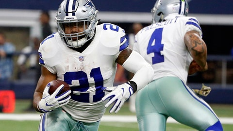 FILE - In this Sunday, Nov. 5, 2017, file photo, Dallas Cowboys running back Ezekiel Elliott (21) carries the ball after taking a hand off from quarterback Dak Prescott (4) during an NFL football game against the Kansas City Chiefs in Arlington, Texas. Elliott and the Cowboys are in legal limbo for the second straight week as the star running back fights his six-game suspension over alleged domestic violence. (AP Photo/Michael Ainsworth, File)