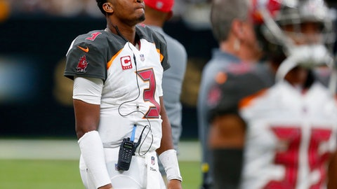 FILE - In this Sunday, Nov. 5, 2017, file photo, Tampa Bay Buccaneers quarterback Jameis Winston (3) watches from the sideline during the second half of an NFL football game against the New Orleans Saints in New Orleans. Winston says consulting Dr. James Andrews about his sore throwing shoulder was ``standard protocol'' and not an indication the injury is worse than he and the Tampa Bay Buccaneers initially believed. The Bucs announced Monday that the third-year pro, who sprained the AC joint in his right shoulder on Oct. 15, will miss at least two games  after re-aggravating the injury during last week's 30-10 road loss at New Orleans. (AP Photo/Butch Dill, File)