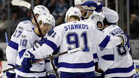 Tampa Bay Lightning's Vladislav Namestnikov, front left, is greeted by teammates after scoring against the San Jose Sharks during the third period of an NHL hockey game Wednesday, Nov. 8, 2017, in San Jose , Calif. (AP Photo/Marcio Jose Sanchez)