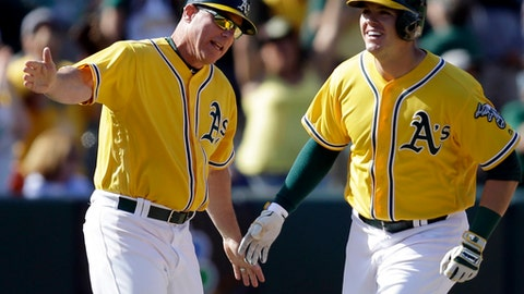 FILE - In this May 7, 2017, file photo, Oakland Athletics' Ryon Healy, right, celebrates with third base coach Chip Hale after hitting a walkoff two-run home run off Detroit Tigers' Francisco Rodriguez in the ninth inning of a baseball game in Oakland, Calif. Former major league skipper Chip Hale will be the bench coach for new Washington Nationals manager Dave Martinez, while Derek Lilliquist will be the team's pitching coach, the Nationals announced, Thursday, Nov. 9, 2017. Hale was Oakland's third base coach last season. Before that, he managed the Arizona Diamondbacks in 2015 and 2016. (AP Photo/Ben Margot, File)