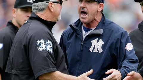 New York Yankees bench coach Rob Thomson argues with crew chief Dana DeMuth during the seventh inning of a baseball game Thursday, Aug. 24, 2017, in Detroit. (AP Photo/Duane Burleson)